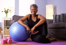 Smiling older woman with exercise equipment