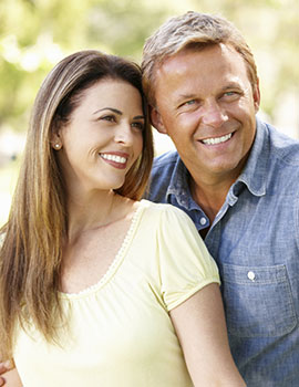 Older couple with Gainesville dental implants