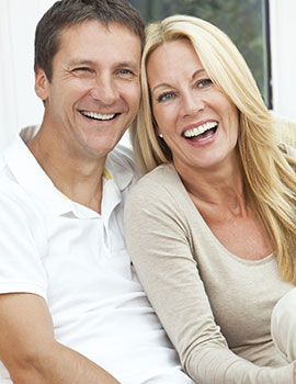 Smiling middle-aged couple at Fairfax dental office